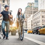 a couple taking bikes in a city