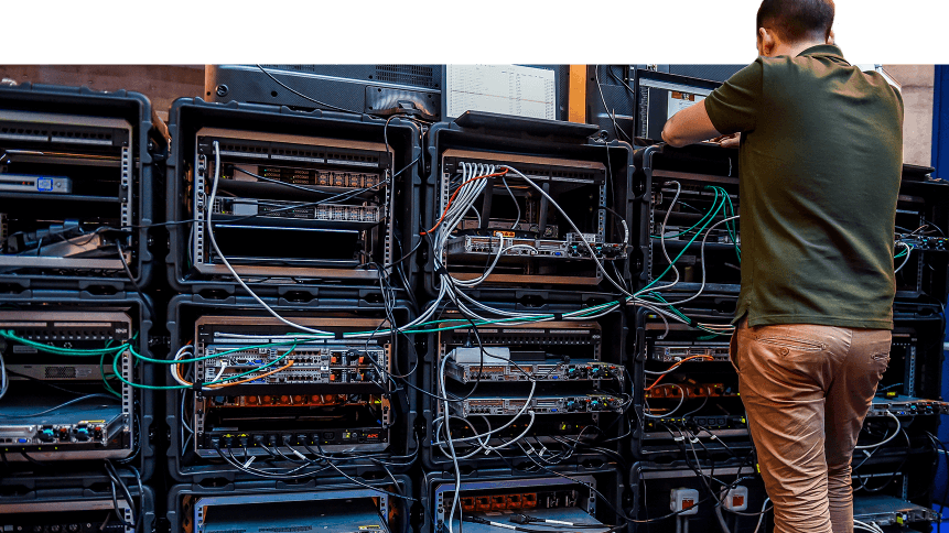 A man works next to servers specialised in cyber security during the 10th International Cybersecurity Forum in Lille