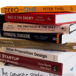 Stack of books related to startups