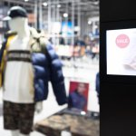 Intelligent Digital Signage , Augmented reality marketing and face recognition concept. Interactive artificial intelligence digital advertisement in fashion retail shopping Mall