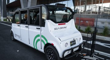 The Optimus Ride autonomous six-seater shuttle bus drives through the Brooklyn Navy Yard