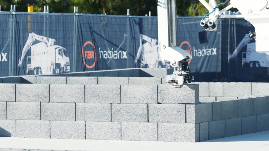 A HadrianX bricklaying robot in action.