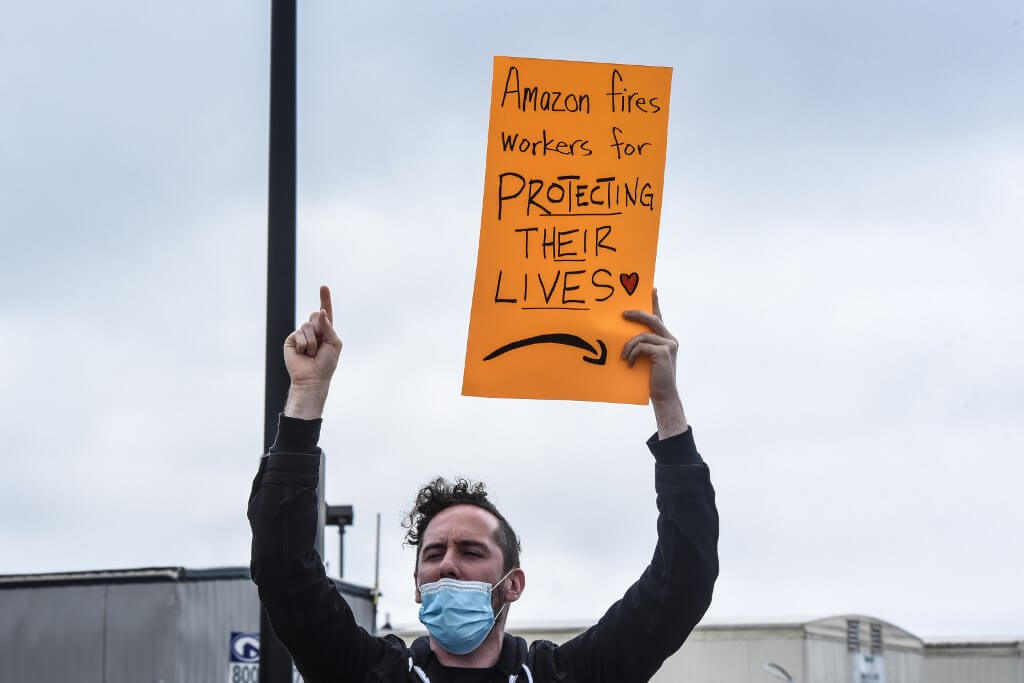 People protest working conditions outside of an Amazon warehouse fulfillment center in New York
