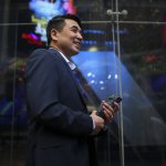 Zoom founder Eric Yuan in front of the Nasdaq building after Zoom's opening bell ceremony on April 18, 2019