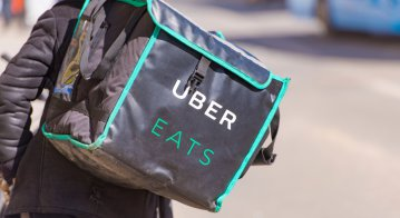 Uber is expanding beyond its core business model. Source: Shutterstock