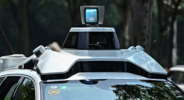 Who should pay if an autonomous vehicle causes an accident: the owner, the carmaker, or the developer of the AI?