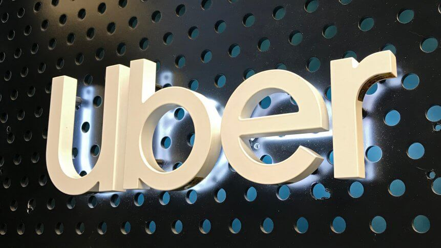 Close up of a lighted Uber logo sign at an Uber lounge at the Westfield Century City mall in Century City.