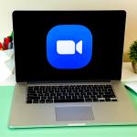 Laptop showing Zoom Cloud Meetings app logo. Manhattan, New York, USA - March 25, 2020.