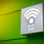 WiFi zone sign and symbol or Wifi area sign on the green wood background with softlight